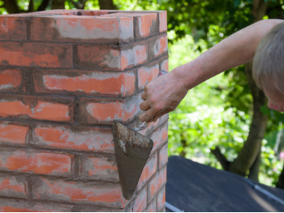 Chimney Tucking & Repairing Process Taking Place In South Bend, Indiana