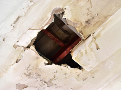Hole In Ceiling From Water Leak In Roof